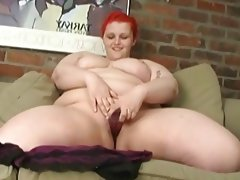 Red head bbw sticks dildo in chubby..