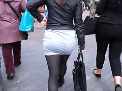 Voluptuous chick wears a gray skirt..